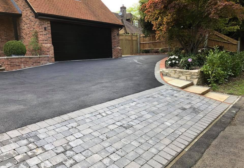 tarmac and cobble stone driveway